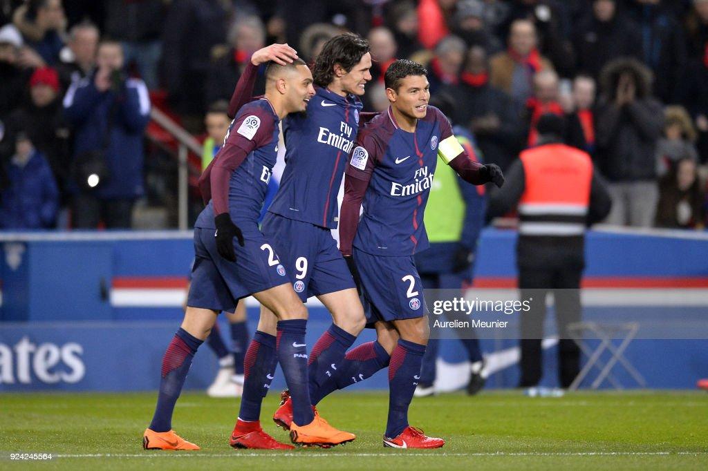 Edinson Cavani of Paris Saint-Germain celebrates his goal with Thiago Silva and Layvin Kurzawa during the Ligue 1 match between Paris Saint Germain and Olympique Marseille February 25, 2018 in Paris, France.