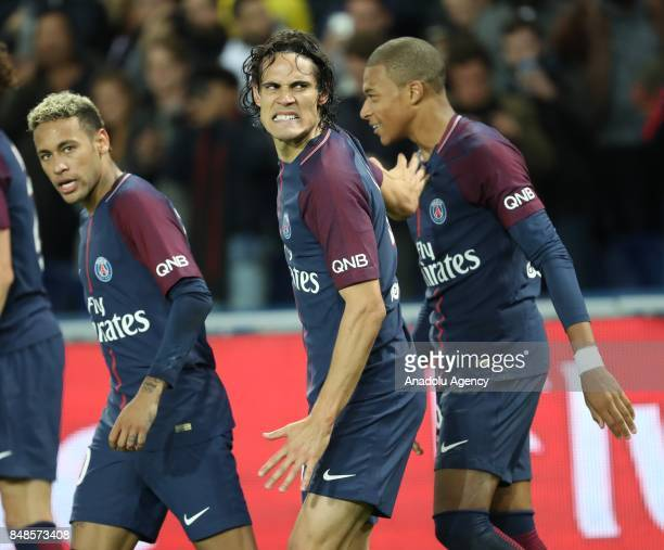 Edinson Cavani of Paris SaintGermain celebrates his score with Neymar and Kylian Mbappe during the French Ligue 1 football match between Paris...