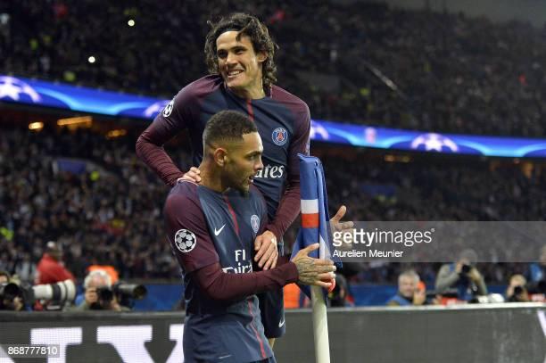 Edinson Cavani of Paris SaintGermain congratulates his teammate Layvin Kurzawa after he scored a hat trick during the UEFA Champions League group B...