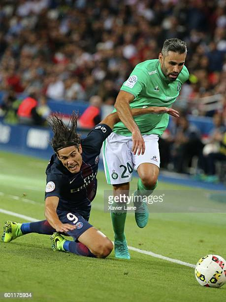 Edinson Cavani of Paris SaintGermain in action with Loic Perrin of AS SaintEtienne during the French Ligue 1 match between Paris SaintGermain and AS...