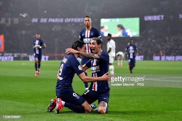 Edinson Cavani of Paris SaintGermain is congratulated by teammate Angel Di Maria after scoring his 200th goal during the Ligue 1 match between Paris...