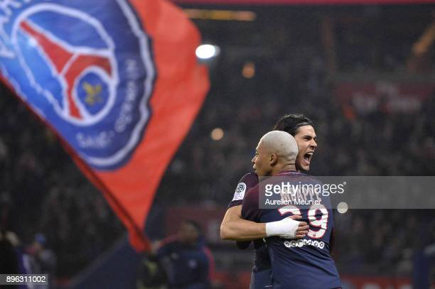 Edinson Cavani of Paris SaintGermain is congratulated by teammate Kylian Mbappe after scoring during the Ligue 1 match between Paris Saint Germain...