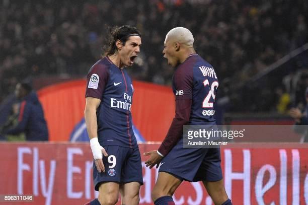 Edinson Cavani of Paris SaintGermain is congratulated by teammate Kylian Mbappe after scoring during the Ligue 1 match between Paris Saint Germain...