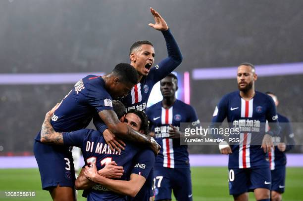 Edinson Cavani of Paris SaintGermain is congratulated by teammates Thilo Kehrer and Presnel Kimpembe after scoring his 200th goal during the Ligue 1...