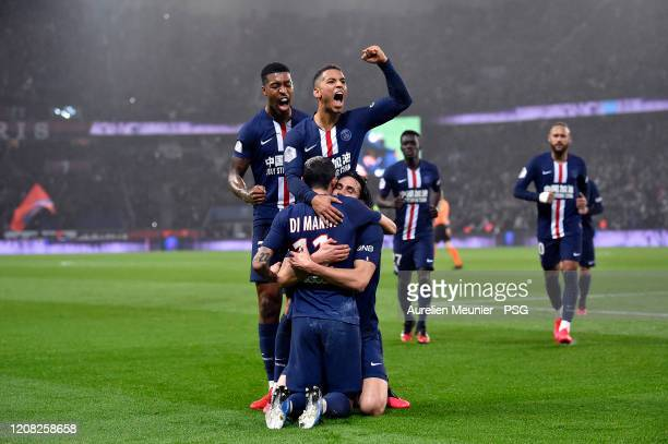 Edinson Cavani of Paris Saint-Germain is congratulated by teammates Thilo Kehrer, Presnel Kimpembe and Angel Di Maria after scoring his 200th goal...