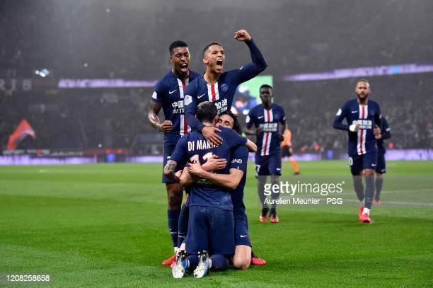 Edinson Cavani of Paris SaintGermain is congratulated by teammates Thilo Kehrer Presnel Kimpembe and Angel Di Maria after scoring his 200th goal...