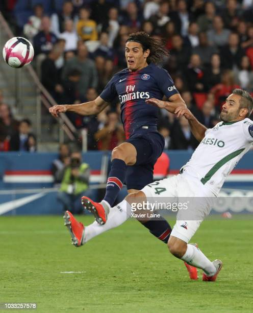 Edinson Cavani of Paris SaintGermain is slash by Loic Perrin of Saint Etienne ASSE during the French Ligue 1 match between Paris Saint Germain and AS...