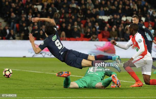 Edinson Cavani of Paris SaintGermain is slash during the French Cup SemiFinal match between Paris SaintGermain and As Monaco at Parc des Princes on...
