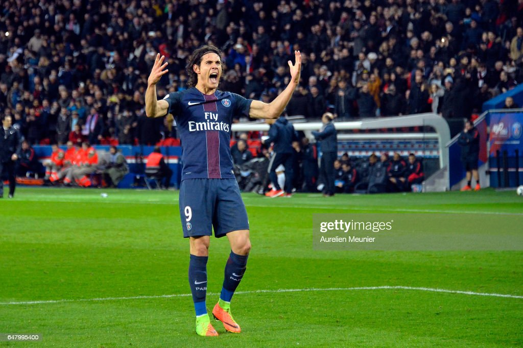 Edinson Cavani of Paris Saint-Germain reacts after scoring during the French Ligue 1 match between Paris Saint Germain and Nancy at Parc des Princes on March 4, 2017 in Paris, France.