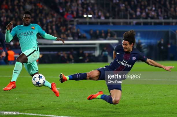 Edinson Cavani of Paris SaintGermain stretches for the ball in front of Samuel Umtiti of Barcelona during the UEFA Champions League Round of 16 first...