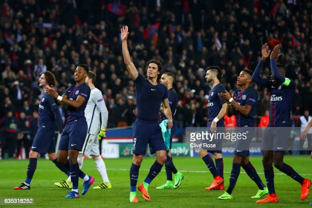 Edinson Cavani of Paris SaintGermain waves to the fans next to his teammates following their victory in the UEFA Champions League Round of 16 first...