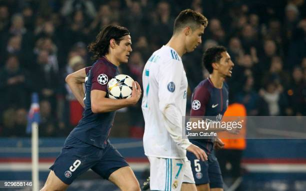 Edinson Cavani of PSG after scoring a goal passes by Cristiano Ronaldo of Real Madrid during the UEFA Champions League Round of 16 Second Leg match...