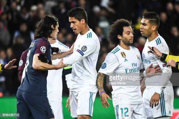 Edinson Cavani of PSG and Raphael Varane of Real Madrid during the UEFA Champions League Round of 16 Second Leg match between Paris Saint Germain and...