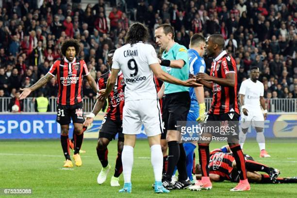 Edinson Cavani of PSG and referee Ruddy Buquet during the French Ligue 1 match between Nice and Paris Saint Germain at Allianz Riviera on April 30...