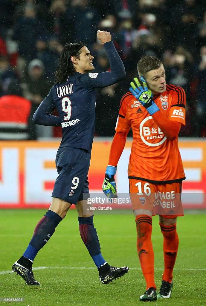 Edinson Cavani of PSG celebrates his goal on a penalty kick while goalkeeper of Lorient Paul Delecroix looks dejected during the French Ligue 1 match between Paris Saint-Germain (PSG) and FC Lorient at Parc des Princes stadium on December 21, 2016 in Paris, France.