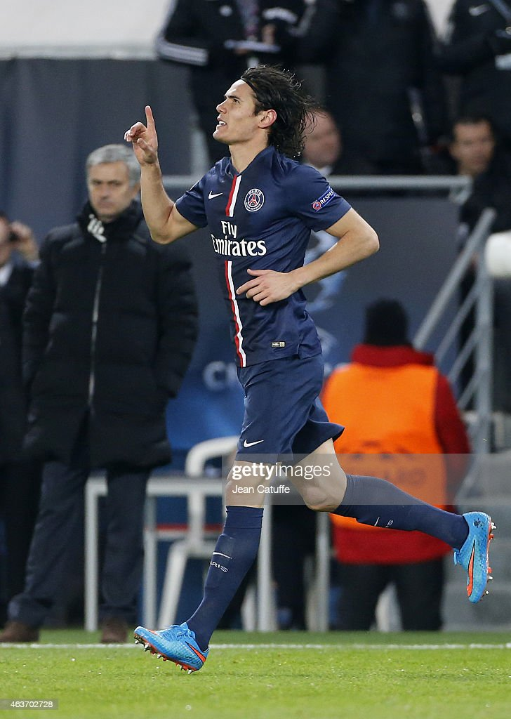 Edinson Cavani of PSG celebrates his goal while head coach of Chelsea Jose Mourinho looks on during the UEFA Champions League round of 16 match between Paris Saint-Germain FC and Chelsea FC at Parc des Princes stadium on February 17, 2015 in Paris, France.