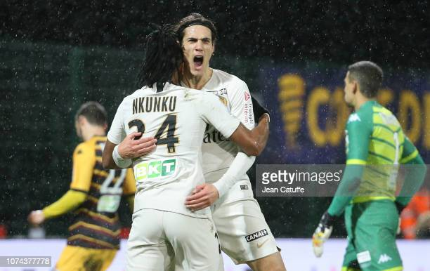 Edinson Cavani of PSG celebrates his goal with Christopher Nkunku during the french League Cup at Stade de la Source on December 18 2018 in Orleans...
