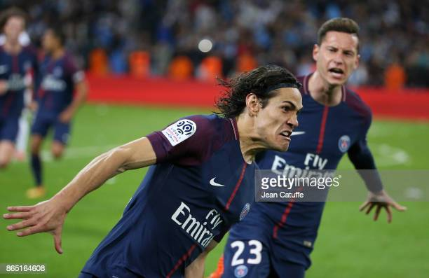 Edinson Cavani of PSG celebrates his goal with Julian Draxler tying the game at the last minute during the French Ligue 1 match between Olympique de...