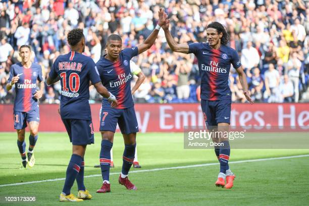 Edinson Cavani of PSG celebrates his goal with Kylian Mbappe and Neymar Jr during Ligue 1 match between Paris Saint Germain PSG and Angers on August...