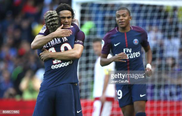 Edinson Cavani of PSG celebrates his goal with Neymar Jr and Kylian Mbappe during the French Ligue 1 match between Paris SaintGermain and FC...