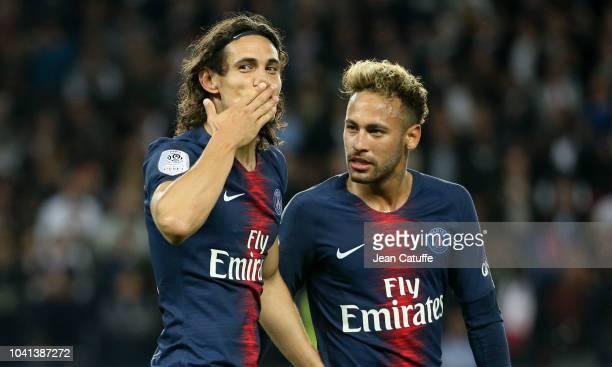 Edinson Cavani of PSG celebrates his goal with Neymar Jr during the french Ligue 1 match between Paris SaintGermain and Stade de Reims at Parc des...