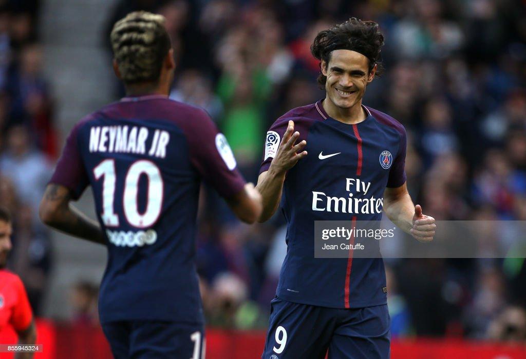 Edinson Cavani of PSG celebrates his goal with Neymar Jr during the French Ligue 1 match between Paris Saint-Germain (PSG) and FC Girondins de Bordeaux at Parc des Princes on September 30, 2017 in Paris, France.