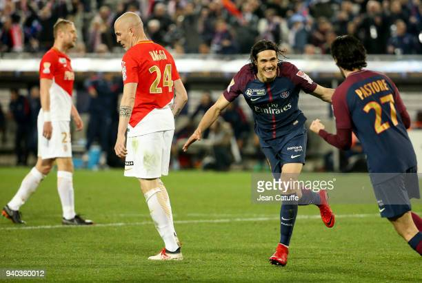 Edinson Cavani of PSG celebrates his second goal while Kamil Glik and Andrea Raggi of Monaco look down during the French League Cup final between...