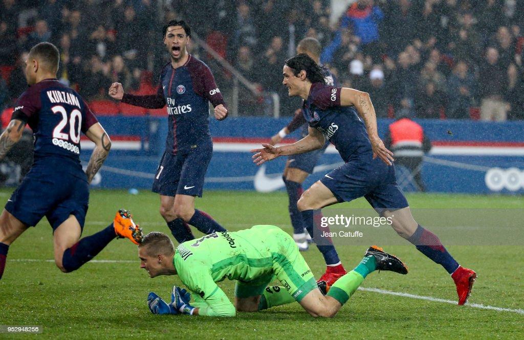 Edinson Cavani of PSG celebrates his second goal with Javier Pastore while goalkeeper of Guingamp Karl-Johan Johnsson lies down during the Ligue 1 match between Paris Saint Germain (PSG) and En Avant Guingamp at Parc des Princes stadium on April 29, 2018 in Paris, .