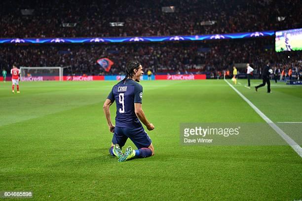 Edinson Cavani of PSG celebrates putting his side 10 ahead during the Uefa Champions League match between Paris Saint Germain and Arsenal at Parc des...