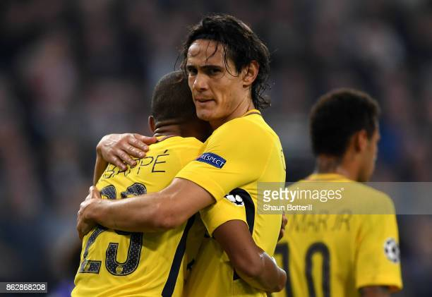 Edinson Cavani of PSG celebrates scoring his sides second goal with Kylian Mbappe of PSG during the UEFA Champions League group B match between RSC...