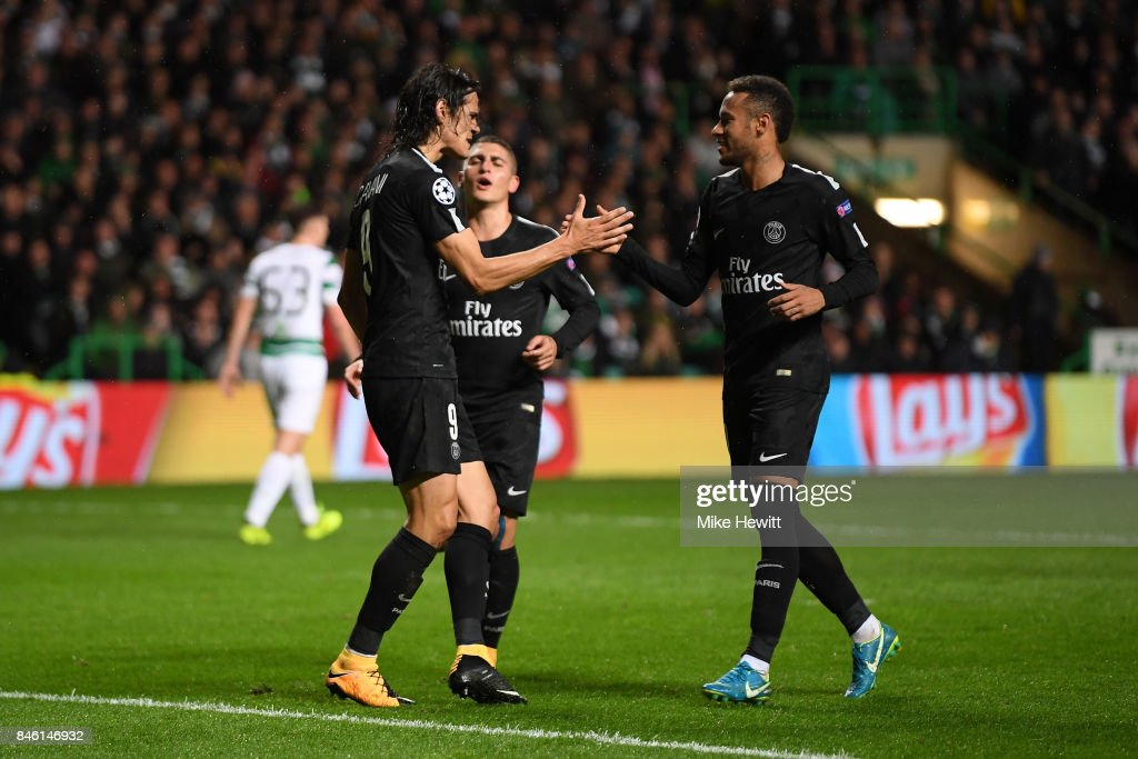 Edinson Cavani of PSG celebrates scoring his sides third goal with Neymar of PSG during the UEFA Champions League Group B match between Celtic and Paris Saint Germain at Celtic Park on September 12, 2017 in Glasgow, Scotland.