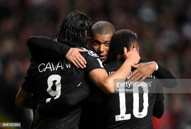 Edinson Cavani of PSG celebrates scoring his sides third goal with Neymar of PSG and Kylian Mbappe of PSG during the UEFA Champions League Group B...