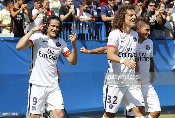 Edinson Cavani of PSG celebrates scoring the second goal for his team with teammates David Luiz and Marco Verratti during the 2015 Trophee des...