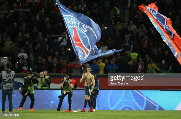 Edinson Cavani of PSG celebrates winning the French Championship following the Ligue 1 match between Paris Saint Germain and AS Monaco at Parc des...