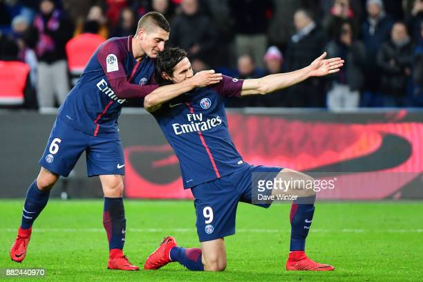 Edinson Cavani of PSG celebrates with Marco Verratti of PSG after putting his side 20 ahead during the Ligue 1 match between Paris Saint Germain and...