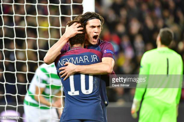 Edinson Cavani of PSG celebrates with Neymar JR of PSG after putting their side 31 ahead during the UEFA Champions League match between Paris Saint...