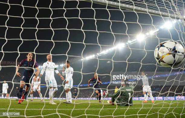 Edinson Cavani of PSG collects the ball as he scores their first goal during the UEFA Champions League Round of 16 Second Leg match between Paris...
