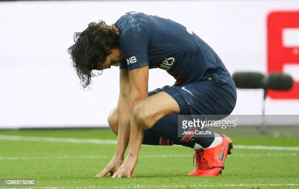 Edinson Cavani of PSG grimaces after getting injured while scoring his goal on a penalty kick during the french Ligue 1 match between Paris...