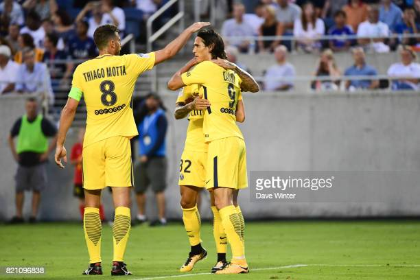 Edinson Cavani of PSG is congratulated after putting his side 10 ahead during the International Champions Cup match between Paris Saint Germain and...