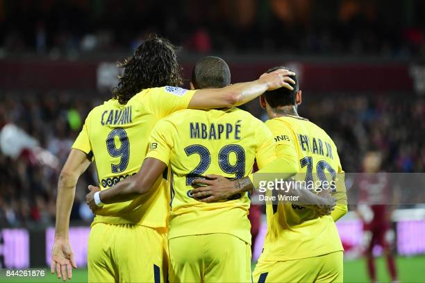 Edinson Cavani of PSG is congratulated by Kylian Mbappe of PSG and Neymar JR of PSG after he puts his side 10 ahead during the Ligue 1 match between...