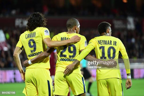 Edinson Cavani of PSG is congratulated by Kylian Mbappe of PSG and Neymar JR of PSG during the Ligue 1 match between Metz and Paris Saint Germain on...