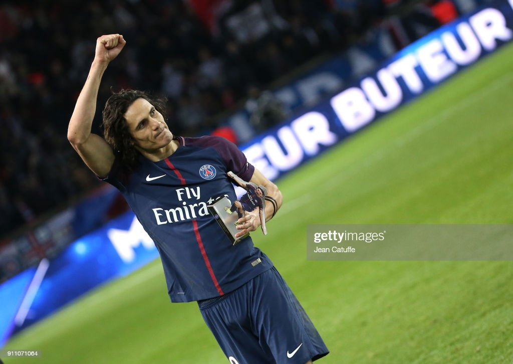 Edinson Cavani of PSG receives a trophy of himself by President of PSG Nasser Al Khelaifi for scoring his 157th goal, beating Zlatan Ibrahimovic's record of goals for PSG following the French Ligue 1 match between Paris Saint Germain (PSG) and Montpellier Herault SC (MHSC) at Parc des Princes on January 27, 2018 in Paris, France.