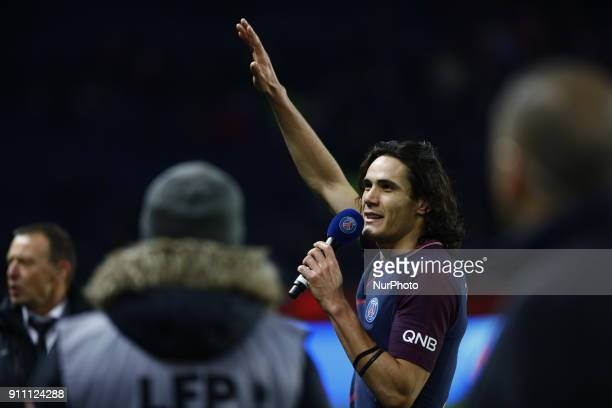 Edinson Cavani of PSG receives a trophy of himself by President of PSG Nasser Al Khelaifi for scoring his 157th goal beating Zlatan Ibrahimovic's...