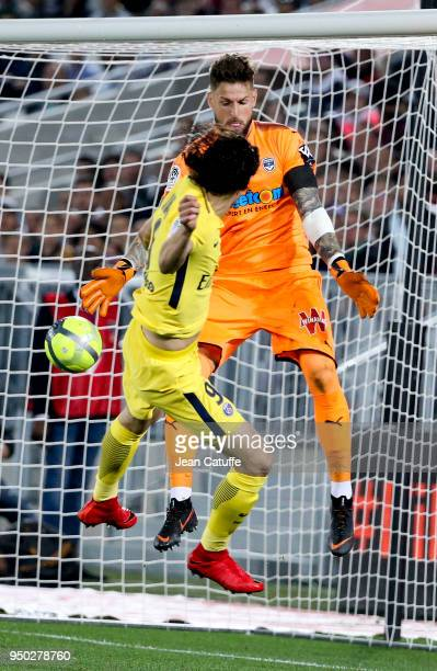 Edinson Cavani of PSG scores a goal against goalkeeper of Bordeaux Benoit Costil but the goal is cancelled during the French Ligue 1 match between FC...