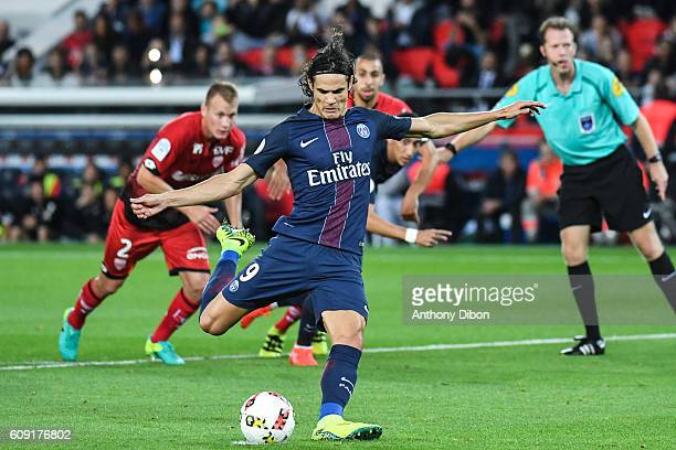 Edinson Cavani of PSG scores a penalty during the French Ligue 1 game between Paris SaintGermain and Dijon FCO at Parc des Princes on September 21...