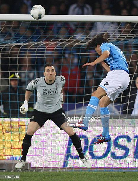 Edinson Cavani of SSC Napoli scores the second goal during the Tim Cup match between SSC Napoli and AC Siena at Stadio San Paolo on March 21 2012 in...