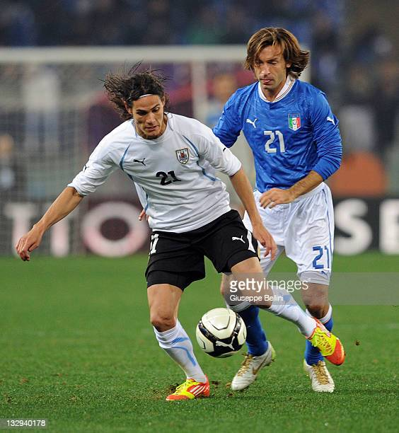 Edinson Cavani of Uruguay and Andrea Pirlo of Italy in action during the International friendly match between Italy and Uruguay at Olimpico Stadium...