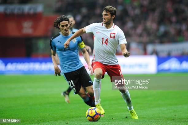 Edinson Cavani of Uruguay and Bartosz Bereszynski of Poland during the international friendly match between Poland and Uruguay at National Stadium on...