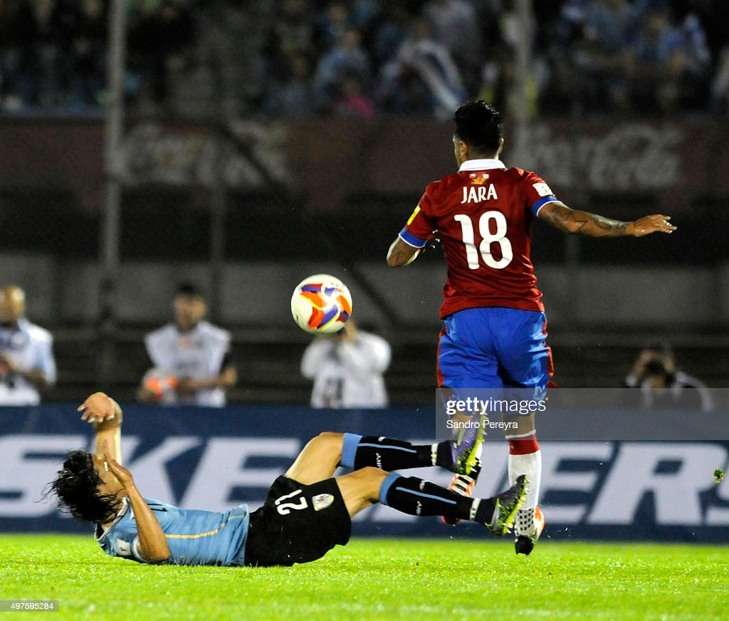 Edinson Cavani of Uruguay and Gonzalo Jara of Chile fight for the ball during a match between Uruguay and Chile as part of FIFA 2018 World Cup Qualifiers at Centenario Stadium on November 17, 2015 in Montevideo, Uruguay.