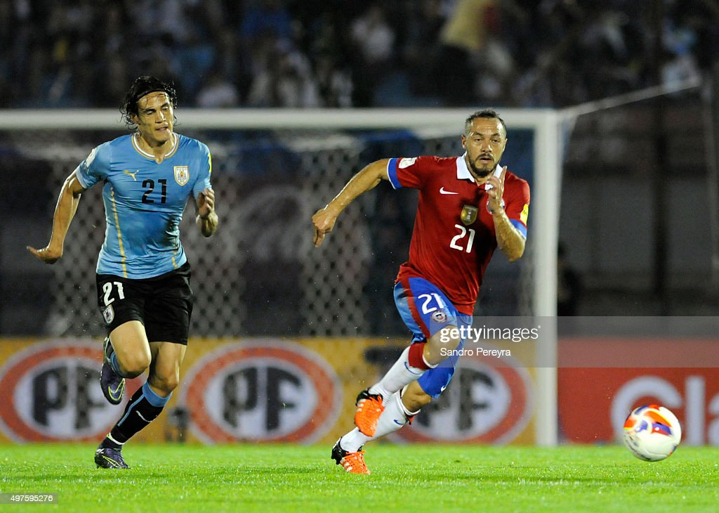 Edinson Cavani of Uruguay and Marcelo Diaz of Chile fight for the ball during a match between Uruguay and Chile as part of FIFA 2018 World Cup Qualifiers at Centenario Stadium on November 17, 2015 in Montevideo, Uruguay.